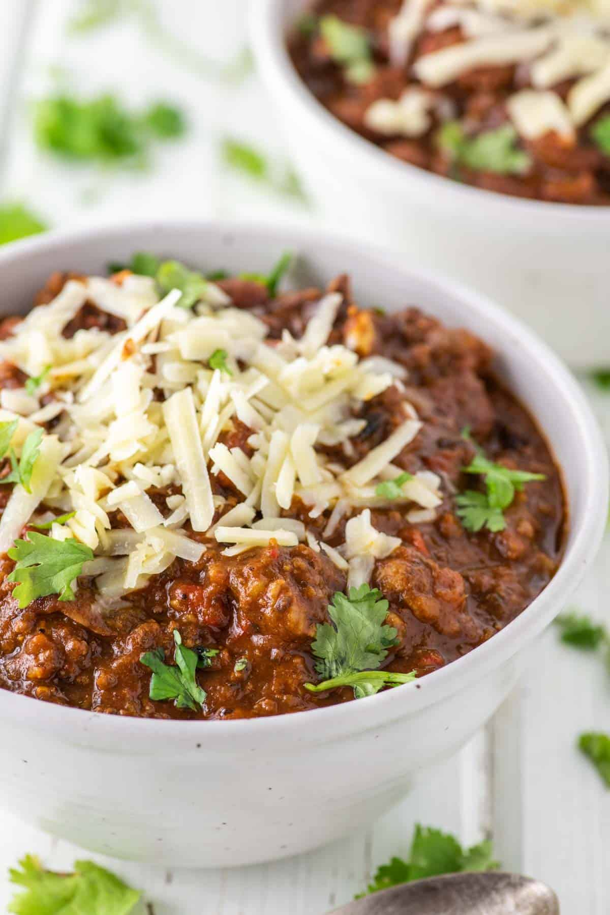 bowl of southern homemade chili with cheese on top