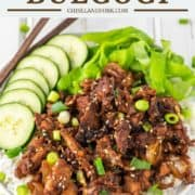 pork bulgogi on top of rice with sliced cucumbers and lettuce