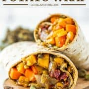 wrap with roasted sweet potatoes and caramelized onions on wood board