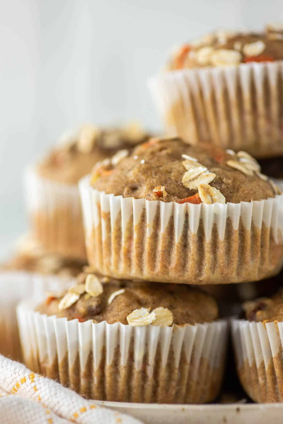muffins made with carrots and bananas stacked on top of each other