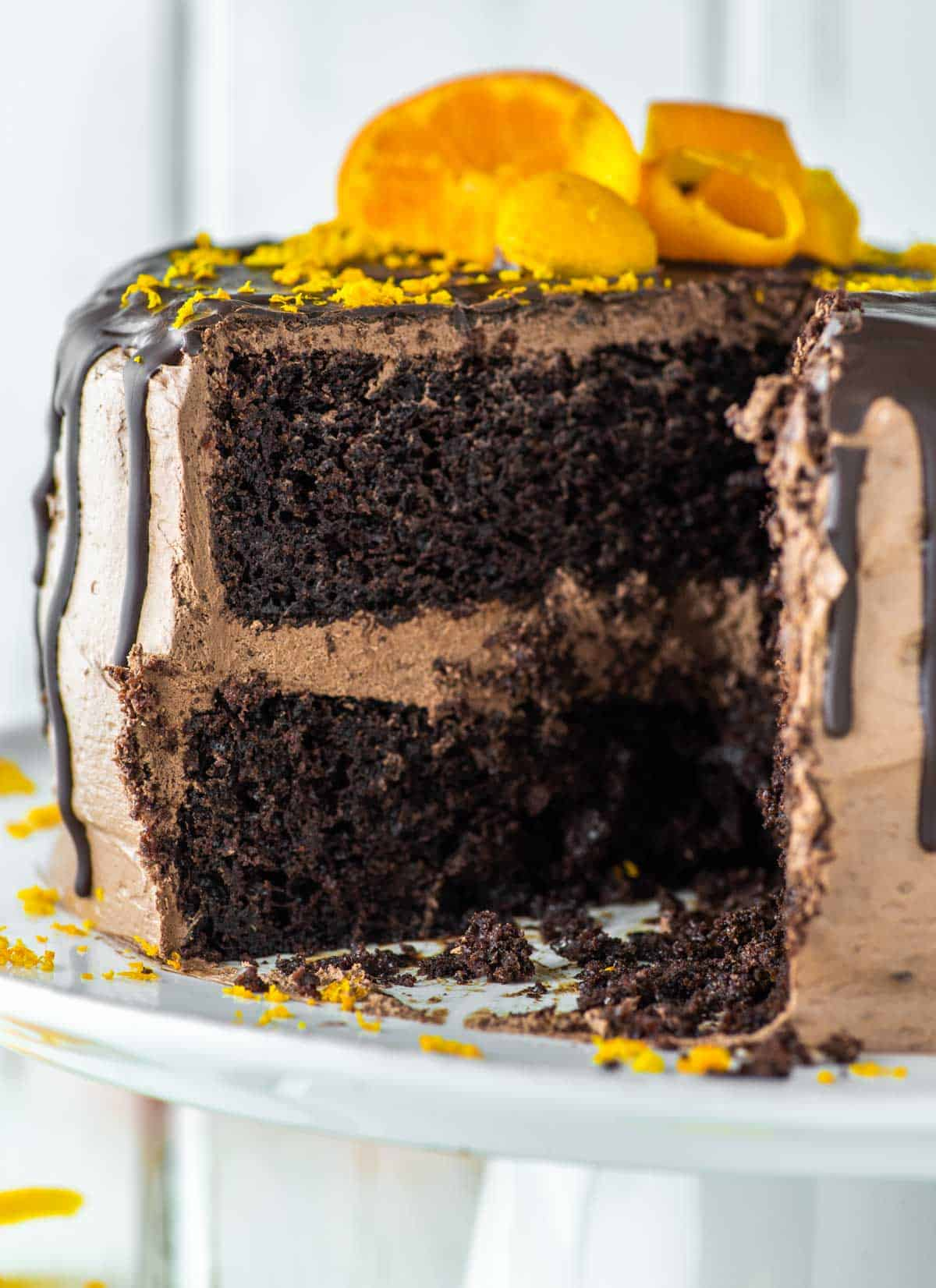chocolate and orange cake cut on white stand