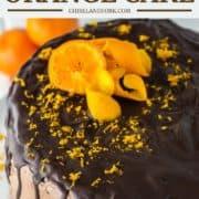 chocolate orange drip cake on white stand