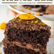 slice of chocolate orange cake on white plate with fork