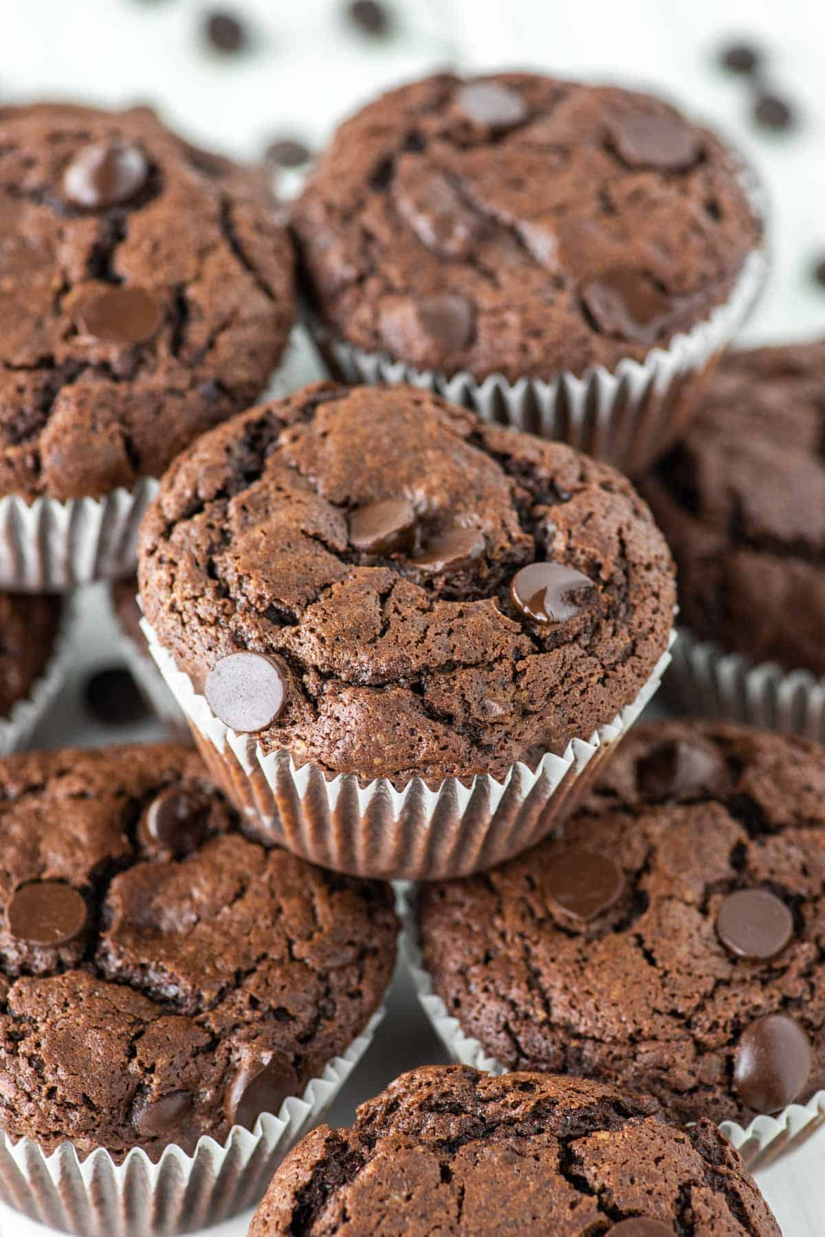 triple chocolate muffins stacked on top of each other