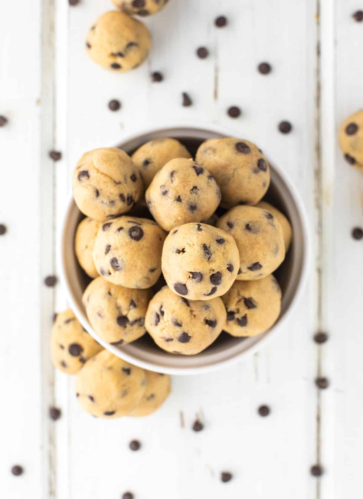 overhead shot of cookie dough bites in white bowl