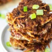 corned beef fritters stacked on white plate