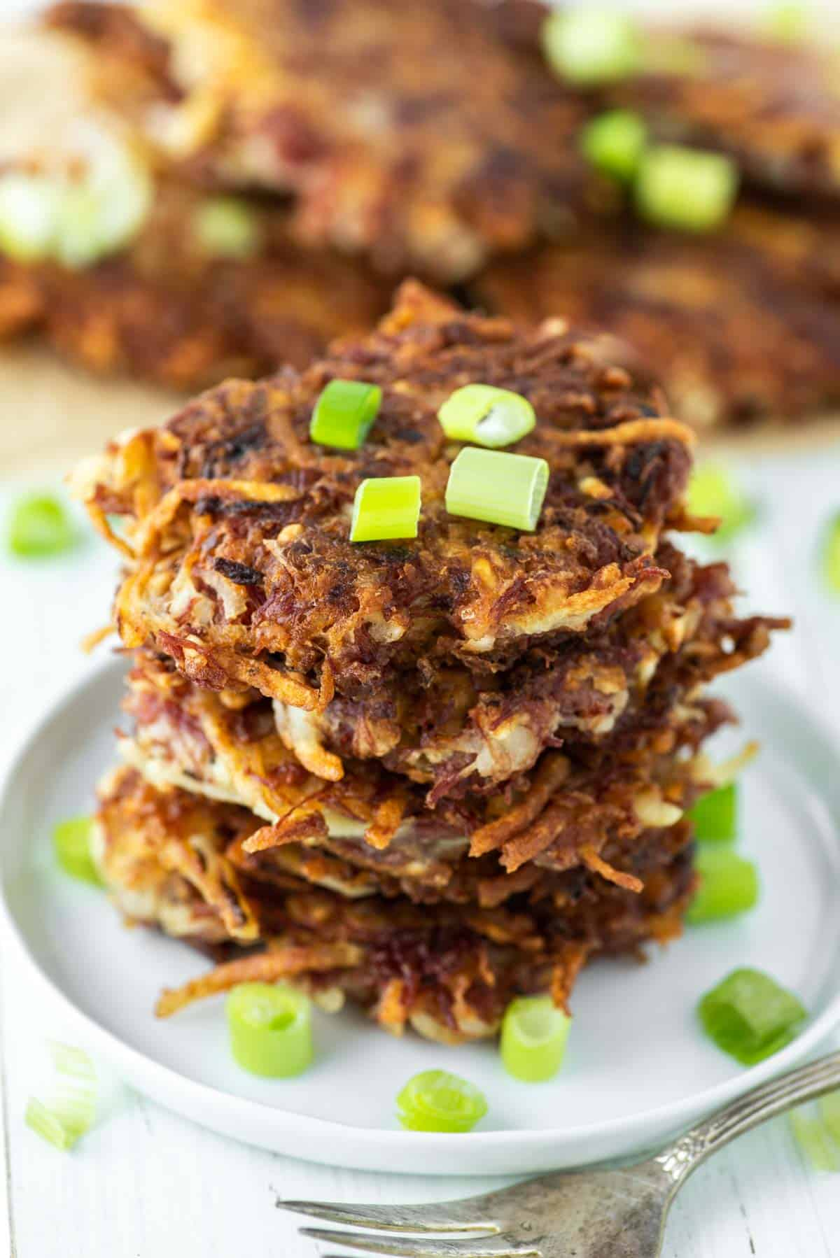 stacked fritters on white plate