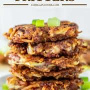 stacked fritters made with corned beef on white plate