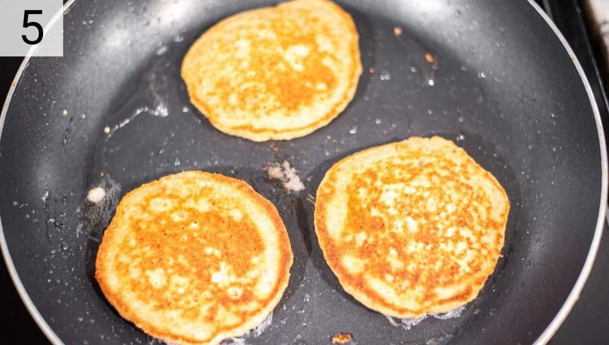 oat flour pancakes in skillet