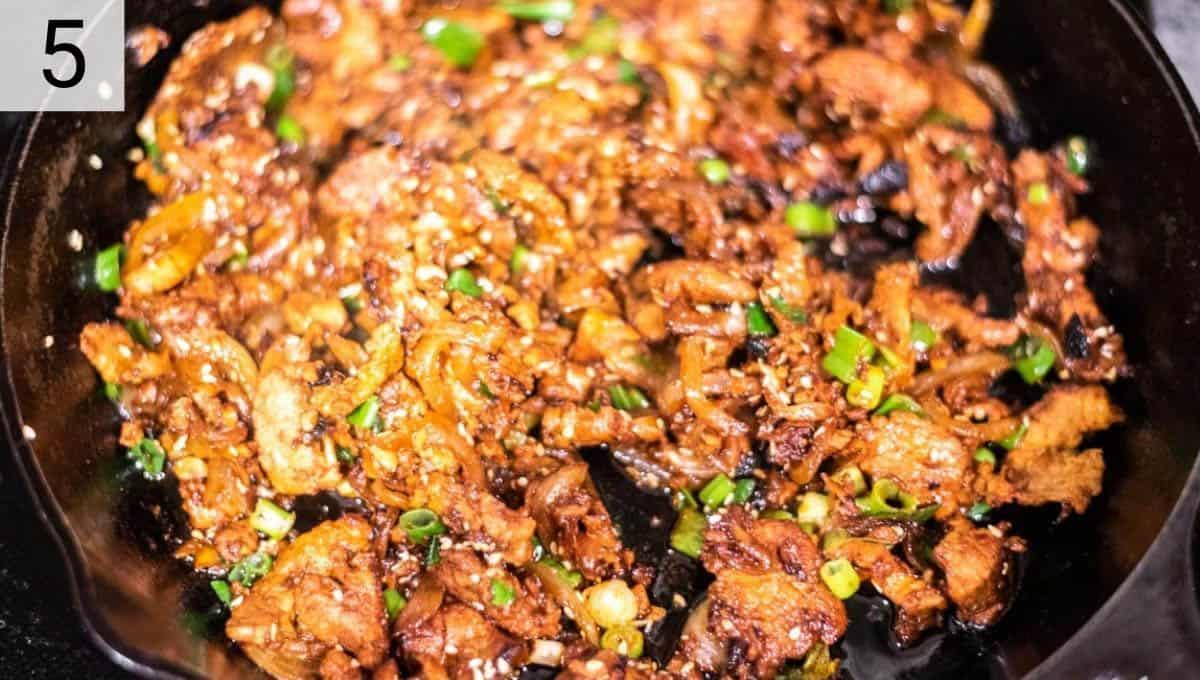 pork bulgogi being cooked in skillet