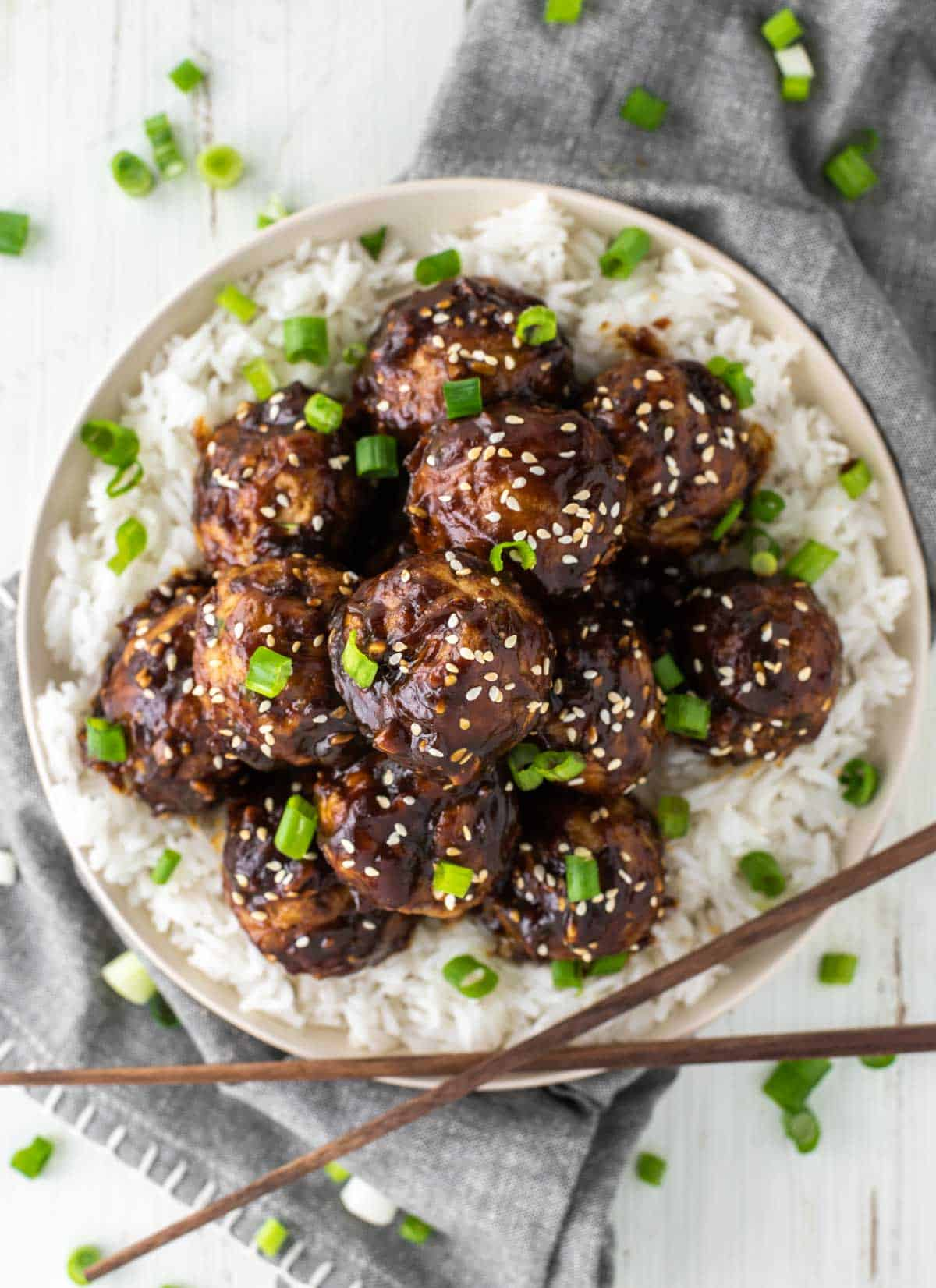 overhead shot of Asian turkey meatballs on plate with rice
