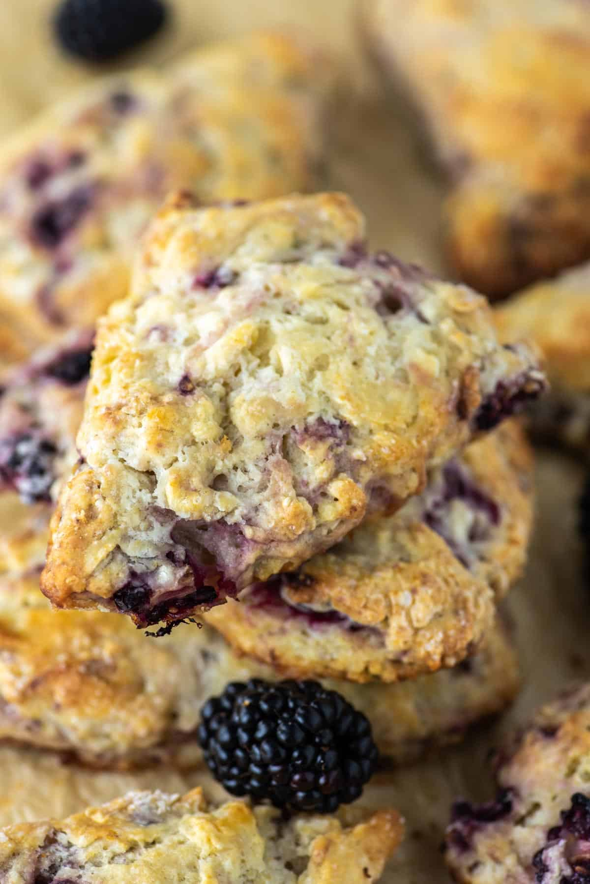 blackberry scones stacked on parchment paper