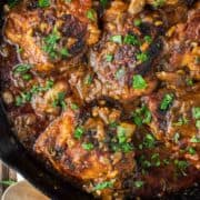 overhead shot of chicken chasseur in skillet