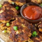 chicken fritters on plate with ketchup