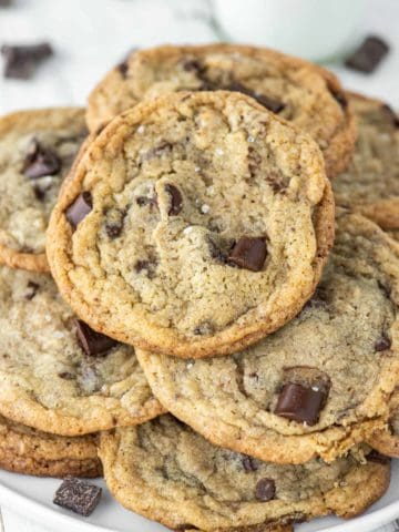stacked eggless chocolate chip cookies on plate
