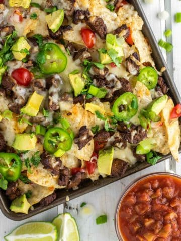 overhead shot of nachos on baking sheet