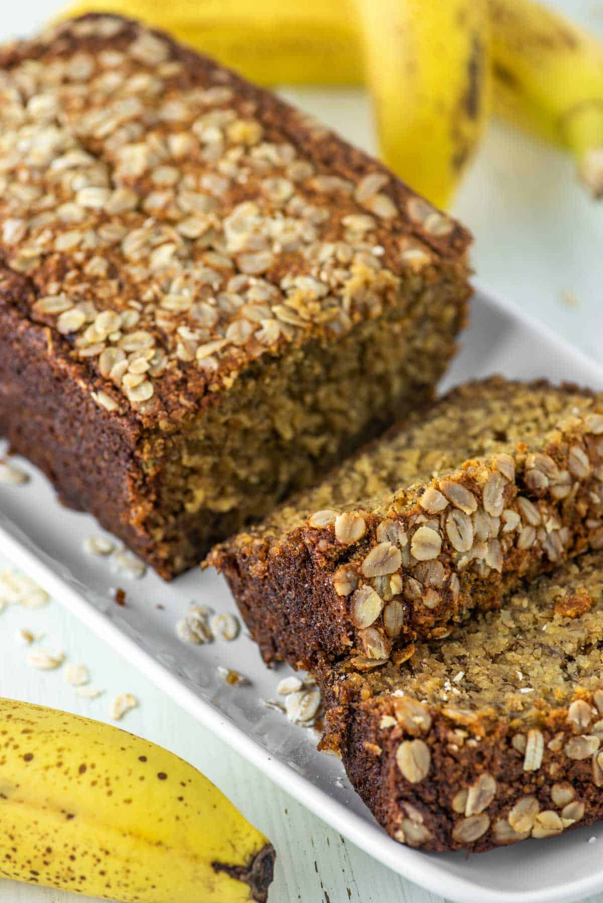 banana bread made with oats sliced on white plate