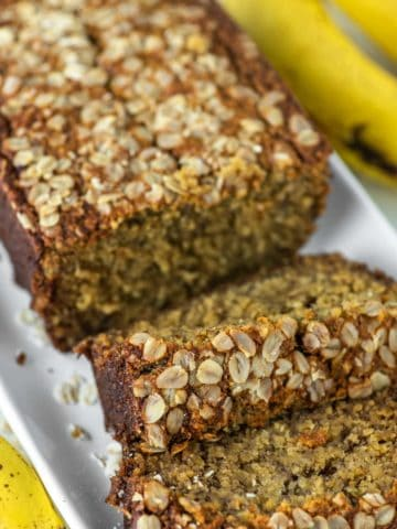 oat flour banana bread sliced on white plate