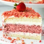 slice of strawberry crunch cake on white plate