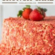 strawberry crunch cake on white cake stand