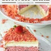slice of strawberry crunch cake on white plate with rest of cake on cake stand
