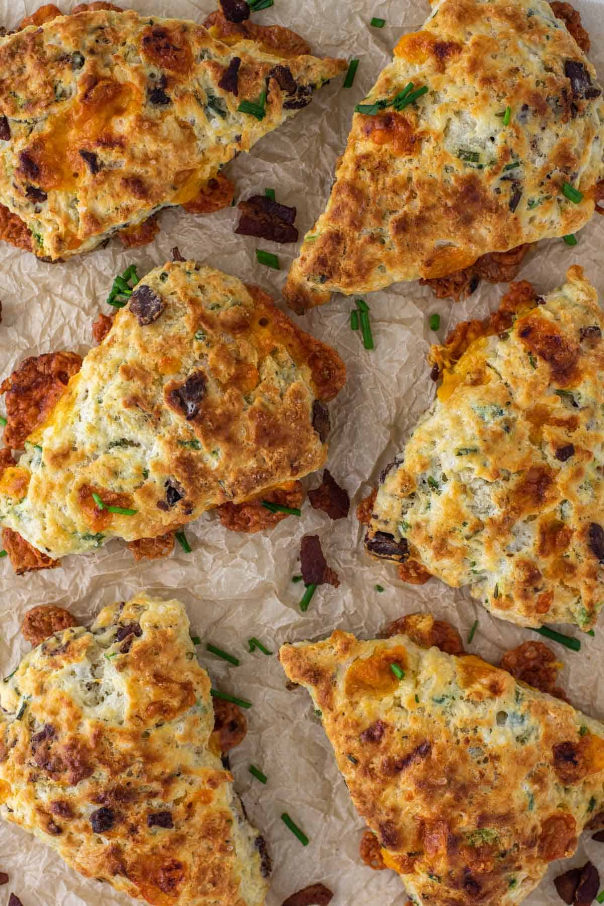 overhead shot of bacon cheddar scones on parchment paper