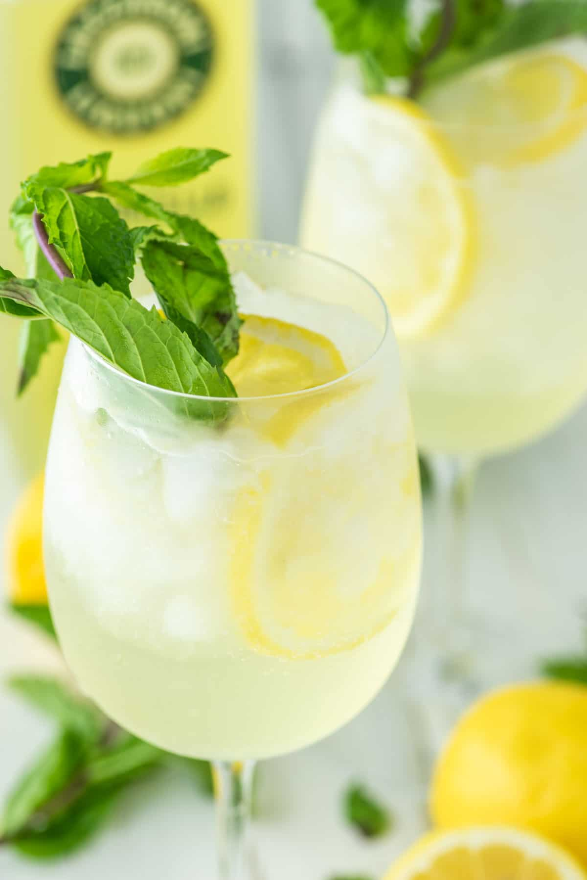 close-up of limoncello spritz in two glasses