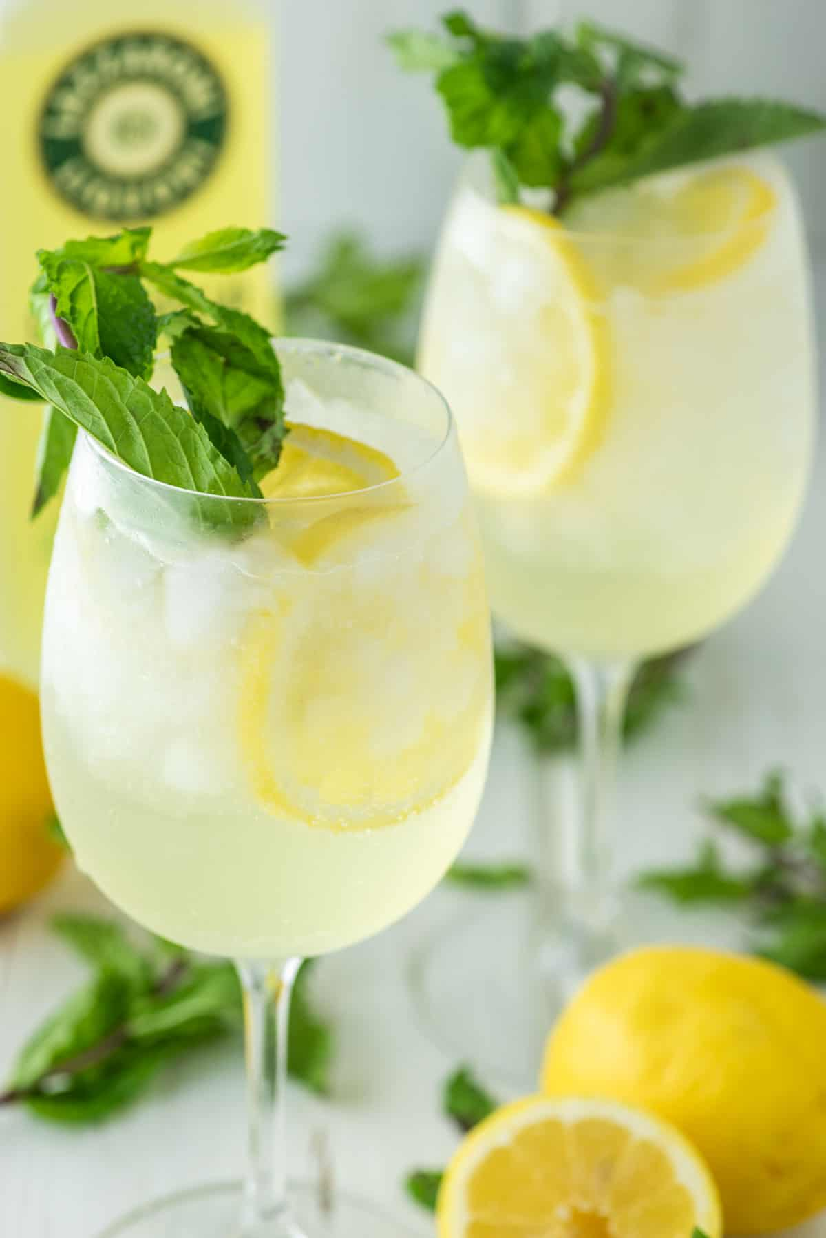 spritz cocktail with lemons and mint in two glasses