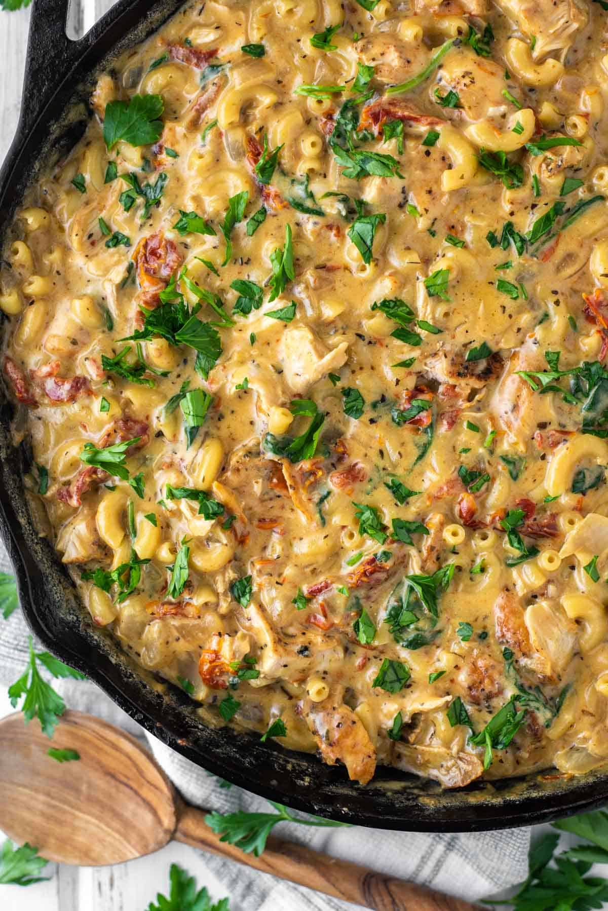 overhead shot of mac and cheese with chicken in skillet