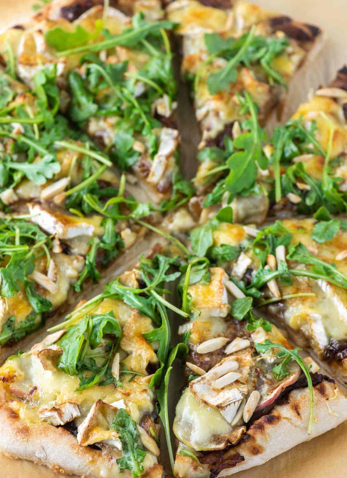 brie pizza on parchment paper