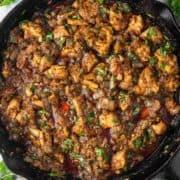 overhead shot of chicken bhuna in cast iron skillet