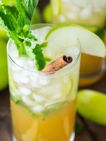 glass of apple mojito with cinnamon stick