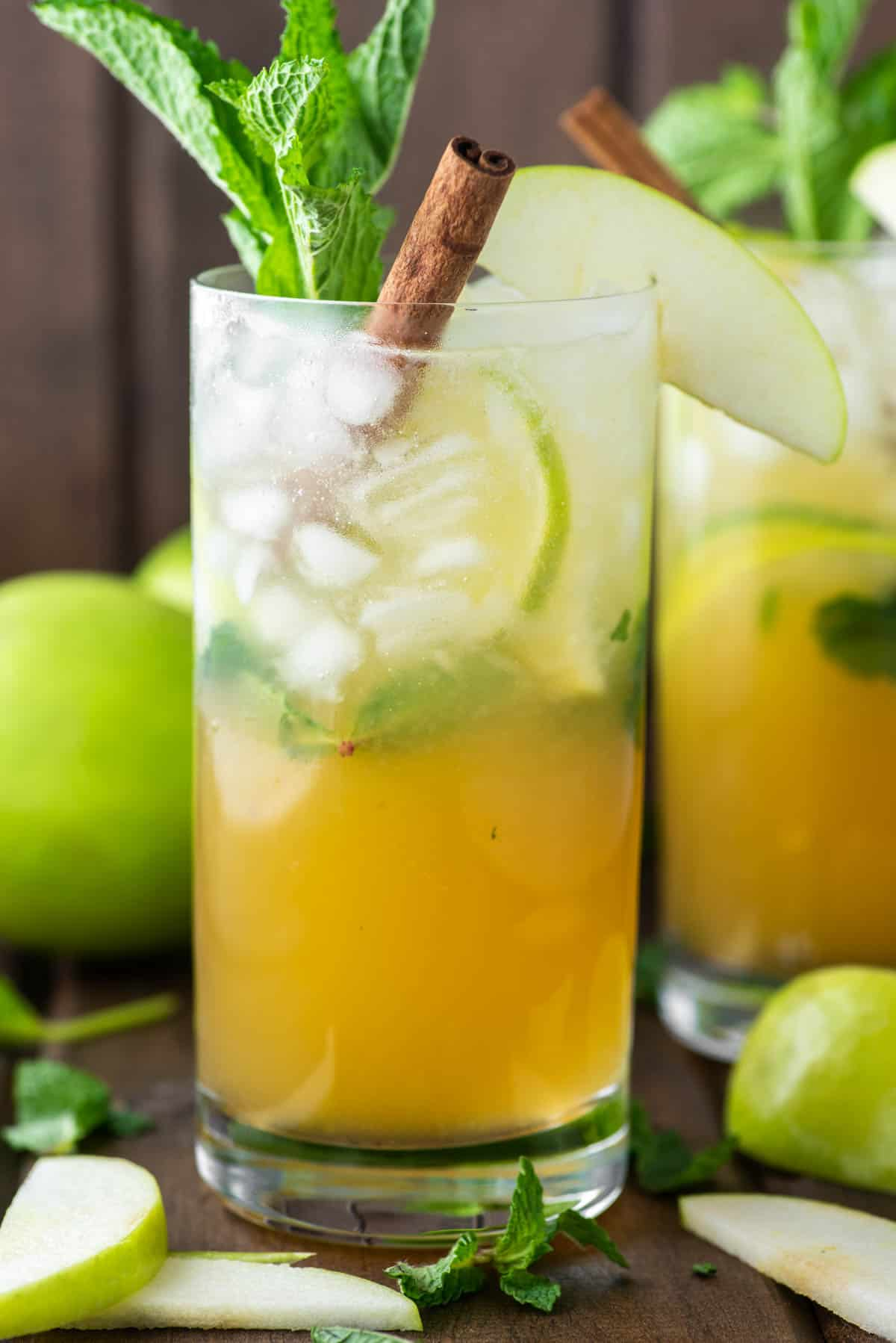 two glasses of apple cider mojitos