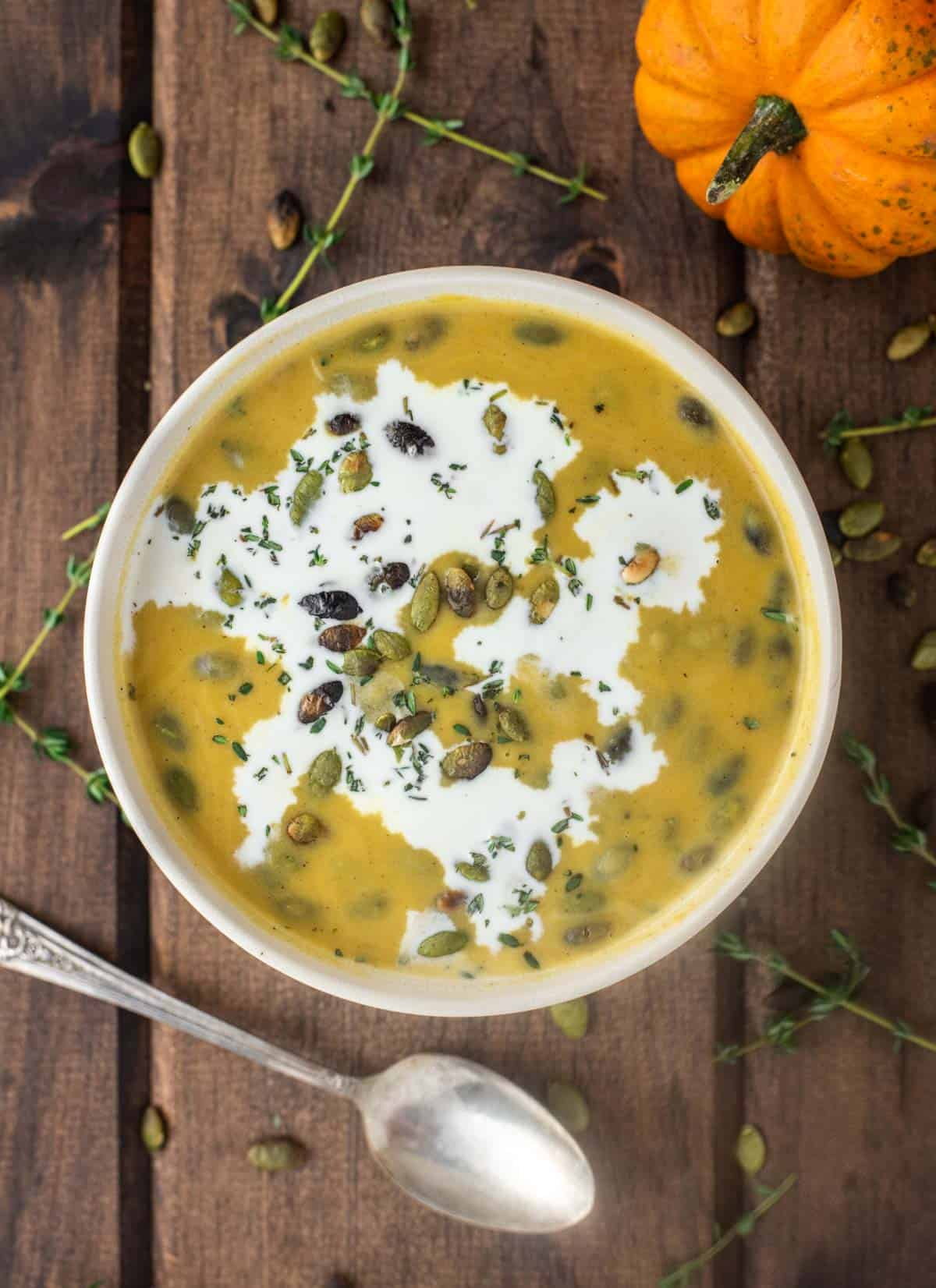 overhead shot of pumpkin and sweet potato soup in bowl