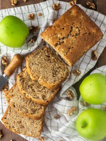 overhead shot of slices of cinnamon apple bread on dish towel